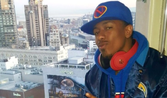 Nick Cannon Is Ready for Super Bowl Wearing a San Diego Chargers Starter Jacket
